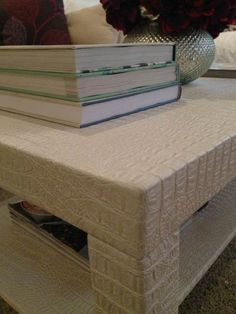 Awesome ikea hack! A lack coffee table upholstered with faux leather gator fabric.