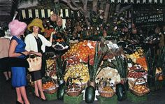 Shopping at the Los Angeles Farmer's Market at night. I'm guessing that the image came from the late 1950s or early 1960s. (Bizarre Los Angeles)