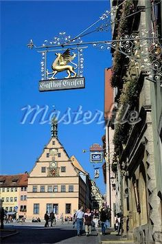 Ornate wrought iron shop sign with the Ratstrinkstube