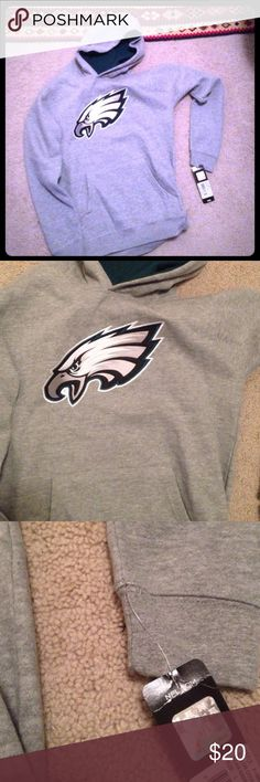 "NFL Philadelphia Eagles Sweatshirt Youth L 🏈 Just in time for football season! 🏈 Authentic NFL Philadelphia Eagles Hooded Sweatshirt (hoodie). Gray with green and white accents.  Philadelphia logo on front.  Kangaroo pockets.  New with tags.  The size is Youth Large (14-16) which fits a Women's XS or a petite Small (my size). Cross-listed on eBay with Free Shipping - search for ""NFL Youth Philadelphia Sweatshirt"" NFL Authentic Merchandise Shirts & Tops Sweatshirts & Hoodies"