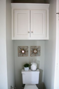 upstairs bathroom...need a cabinet over toilet like this.