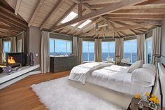 I ADORE visible rafters!!! And the fireplace, and that VIEW!!!