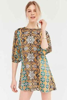 Floral tile pattern silk shift dress from romantic-femme brand For Love & Lemons, the Teresa mini dress features semi-sheer cropped poet sleeves with stretchy cuffs. In a loose, pullover fit finished with a crew-neck. #blueroofind