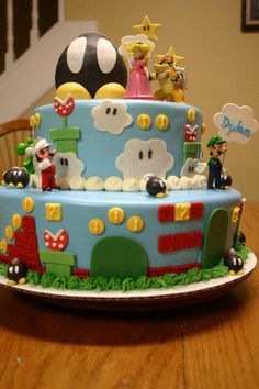 Mario brothers cake.    https://m.facebook.com/mandysbonappetreats#
