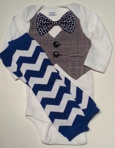 Baby Boy Onesie With Black And White Vest Attached, Dark Blue And White Chevron Leg Warmers, And A Matching Dark Blue And White Bow. on Etsy, $29.99