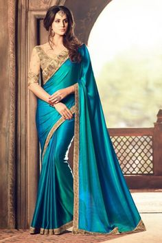 Look beautiful and traditional in this festive season with this tremendous sky blue color party wear saree. This designer saree is adorned with fancy work and made with silk fabric. When you pair this lovely saree with accessories it gives you a diva look