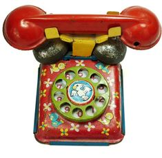 Antique toy telephone decorated with birds