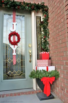 """Use the circular shape of a wreath to your advantage, replacing it as the """"O"""" when spelling out """"Joy"""".  Get the tutorial at Sand & Sisal »   - GoodHousekeeping.com"""