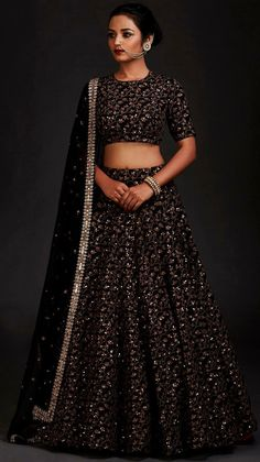 Black color traditional wedding wear lehenga choli for bride. Heavy sequence embroidered work making this Indian lehenga more gorgeous and best suits for special occasions. Indian Lehenga, Black Lehenga, Raw Silk Lehenga, Indian Gowns, Indian Wear, Heavy Lehenga, Lehenga Choli Designs, Lehenga Choli Online, Sarees Online