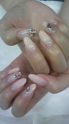 I know that some would think that these are ugly nails, but I would take off the jewels from the nails, and instead add some glitter to them.