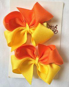 Lazos colores combinados naranja amarillo Precio $60
