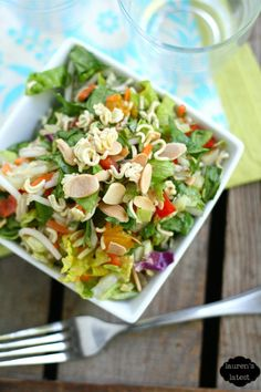 Chinese Chop Salad 1 romaine heart, chopped 2 cups shredded cabbage {I used the store bought coleslaw mix} 1 cup shredded carrot 1 red bell pepper, chopped 3 green onions, sliced 1/2 bunch cilantro, chopped 8 oz. drained mandarin oranges 1/2 c toasted almonds 1 pkg ramen, broken dressing- 2 cloves garlic,  minced 1 T ginger, minced 3 T soy sauce 1/4 c brown sugar 2 T sesame oil 2 T white wine vinegar  1/4 c canola oil salt pepper OR 2/3 c prepared sesame ginger dressing