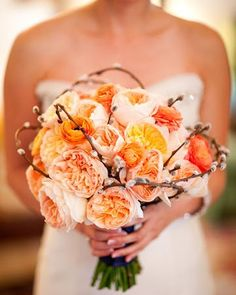 I really like this but not sure if it would match.  We could change the flowers to purple ones or add purple in with this color.  I just really like this branch thing that is wrapped around.  Orange Wedding Bouquets,Orange bridal bouquets