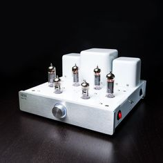 The Glow Amp Two is a push-pull stereo tube amplifier producing 15 watts per channel, featuring EL84 power tubes. Like the classic Glow Amp One, it was assembled by hand, utilizing the point-to-point method, to assure years of durability, reliability and superior performance. This piece has impressive bass output and plug-and-play.