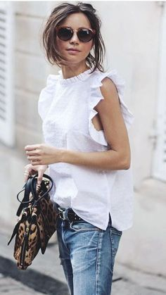 White ruffled sleeve tank, blue jeans, sunglasses, animal print purse