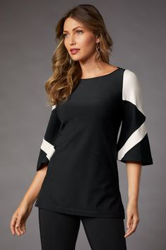 Color-block details create striking lines on this flare-sleeve, tunic-length top. Travel and work-approved, create versatile looks with our other travel collection pieces. So