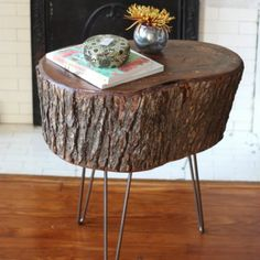 OMG!  I love this!   Easily make a natural side table with a slice of tree stump and 3 hairpin legs!