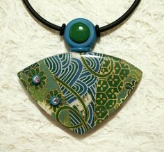 Washi Paper over Polymer Clay by Sweet2Spicy, via Flickr