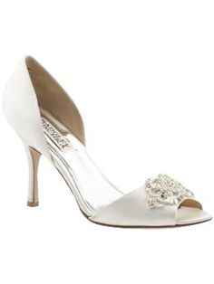This is definitely what I have in mind for my wedding shoe, but at $215.00 it's way out of my price range. Sigh.