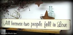 "This wooden sign is made from pine, and measures Approx 3.5""W x 25""L. It reads ""All because two people fell in love"". The front is painted then distressed, the back is stained . Due to our distressing"
