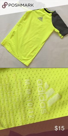 BOYS ADIDAS COMPRESSION TEE BOYS ADIDAS COMPRESSION TEE. Never worn. Yellow/grey. Size med 10-12. Fits tight! Adidas Shirts & Tops Tees - Short Sleeve