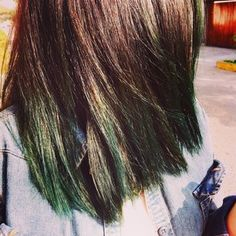 You can add dark green undertones to your brunette locks. | 35 Low-Key Ways To Add Color To Your Hair