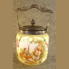 Beautiful hand-painted and transfer ware applied decoration enhance this silver plated biscuit jar.