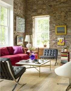 Colorful cottage with light wood flooring and beautiful Barcelona chairs. Looks totally relaxing!