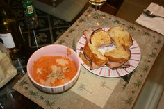 Homemade Ham and Cheese Sourdough Sandwiches dipped in Tomato Basil Bisque