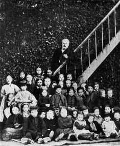 Victor Hugo with his chers enfants pauvres, by Arsene Garnier, Hauteville House, Guernsey, 1868