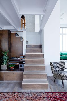 Cécile Figuette's home in Paris-like the simple visual impact of a darker riser with light steps.