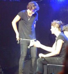 this was sooo funny when the girl threw this on stage and haz picked it up all confused and asked Lou what it was haha