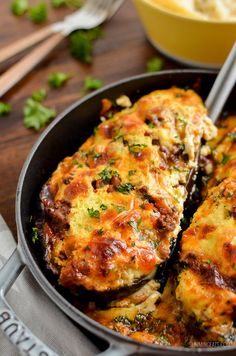 Delicious Syn Free Stuffed Eggplant with ground beef in a delicious tomatoey sauce topped with ricotta and mozzarella - heavenly.