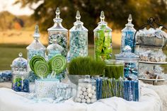 A fun, cheap and impressive centerpiece  (or Easter/spring decoration around your home)  is to grow grass seeds in a container.   I ...