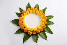 flower rangoli made using marigold or zendu flowers and mango leaves Rangoli Designs Flower, Colorful Rangoli Designs, Rangoli Ideas, Rangoli Designs Images, Rangoli Designs Diwali, Flower Rangoli, Beautiful Rangoli Designs, Easy Rangoli, Diwali Rangoli