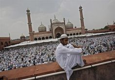A Muslim man sits on the balcony of the Jama Masjid (Grand Mosque) before offering last Friday prayers ahead of Eid-al-Fitr in the old quarters of Delhi August REUTERS-Adnan Abidi Lakshadweep Islands, Jama Masjid, Festivals Of India, Eid Al Fitr, Muslim Men, Grand Mosque, Ramadan, Taj Mahal, Religion