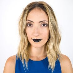 Pin for Later: This Silver Eye Makeup Is Sure to Set a Trend For Halloween Coat lips with black stain