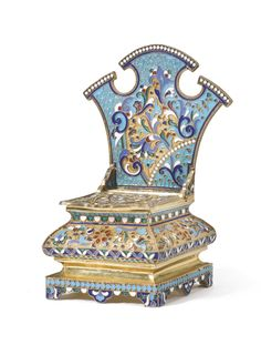 A silver-gilt and cloisonné enamel salt chair, Mikhail Zorin, Moscow, 1908-1917, the bombé seat and shaped back decorated with foliate forms in translucent red, green, opaque blue and white enamels on stippled and scrolled turquoise grounds.