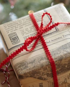 Vintage inspired wrapping paper with a simple red bow.