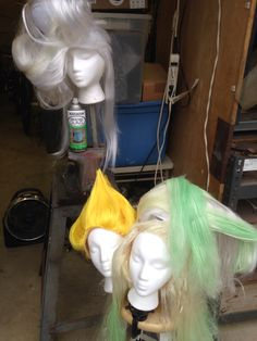 I worked on 2 or 3 wigs at a time between drying.  Add in small sections of colored hair here as well as white which will ultimately be spray painted in uv-activated spray paint.  Note that the base of the wigs may need weft hair glued  around edges for a more realistic hairline.