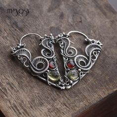 In Raspberry Thicket - Wire wrapped earrings, fine silver, sterling silver, red garnet, lemon quartz. Snake earrings by mgypsy.