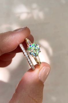 By Erstwhile diamond solitaire engagement ring made in yellow gold and centered with a GIA certifi… [Video] Gold Ring Designs, Ring Design In Gold, Black Diamond Jewelry, Turquoise Jewelry, Budget Planer, Solitaire Engagement, Green Engagement Rings, Baguette Engagement Ring, Baguette Ring
