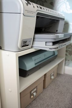 Use a shoe shelf for printer, laminator, external harddrive storage under a desk or counter.