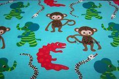 Reststück  ZNOK Monkey & ELephant, türkis    Stoff im skandinavischen Design        95 % Baumwolle, 5 % Elasthan      Die Figuren sind ca 6cm groß    Sie bieten auf 0,48m x 1,55m           Design: Johanna Ahlard für ZNOK-Design