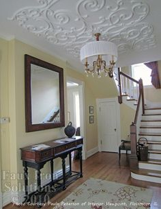 Faux Iron Solutions.  Light weight ceiling treatments.  This one is painted to look like plaster filigree.
