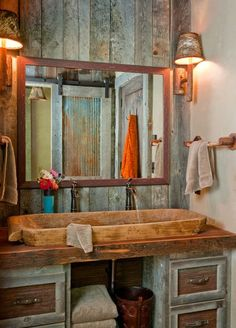 . This is a bathroom designed by Highline Partners, and it's from a home in Big Sky, MT. Since the bathroom was tiny, a mirror was added on ...