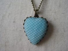 Hey, I found this really awesome Etsy listing at http://www.etsy.com/listing/90936747/heart-blue-necklace-brass-glass-texture