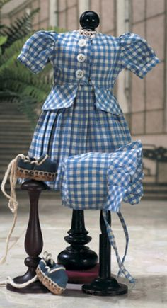 J'aime Ma Bleuette : 215 Mon Beau Village Lot Number:  215 costume #15 in the Winter 1949/1950 catalog,comprising blue and white cotton checkered two-piece sundress with pleated skirt,and matching sunbonnet with pleated brim. Along with blue espadrilles Realized Price:  $225