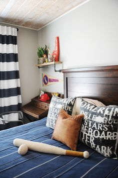 Gteat accessories from HomeGoods mixed with some vintage finds and a fun navy blue and red color combo create a fun and sophisticated tween boy room that can grow with him.  Sponsored pin.
