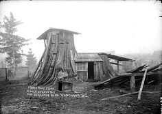 Tree house, Mount Pleasant, pre-1910  Major Mattews' note on the photo:    Mount Pleasant pioneer's shack in stump, photo taken before 1910. It was built by a Mr Berkman and was on the east side of Seacombe Road, now Prince Edward Street, between 26th & 27th Avenues. The location is now 4230 Prince Edward St. It was reached by a short forest trail from Horne Road, now 28th Ave. The lower stump on right was the kitchen, the lower part of the higher stump on left was the livi